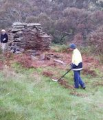 Using a meetal detector around the old stone chimney